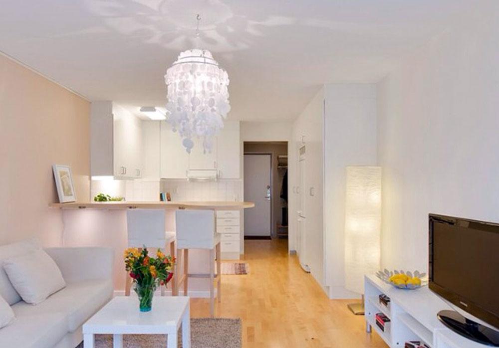 Светлый интерьер квартиры-студии в белых и бежевых тонах