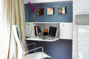 Рабочую зону можно обустроить в углублении, выделив ее контрастным цветом стены