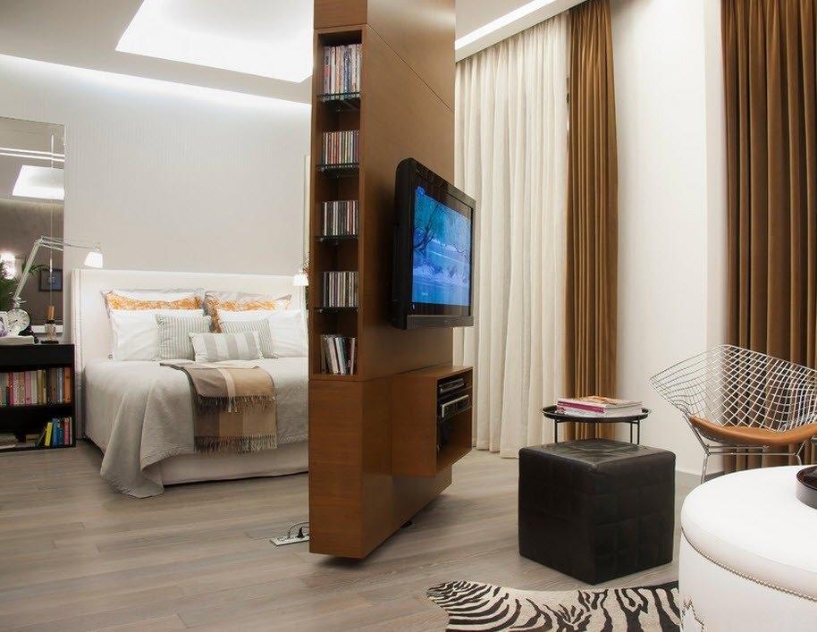 Вращающийся стеллаж разделит вашу комнату на две отдельных зоны